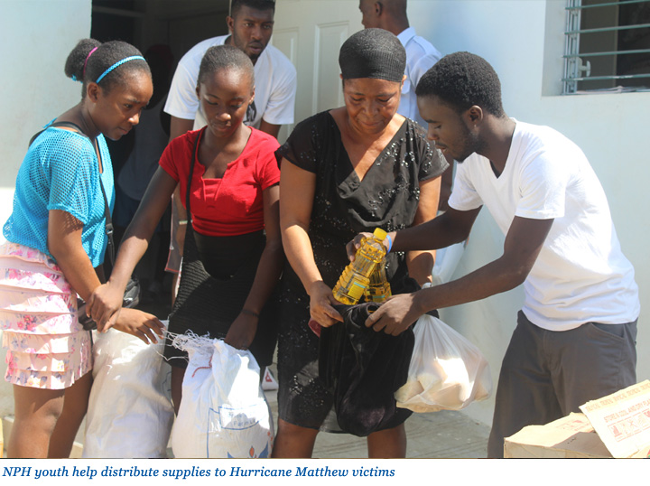 NPH Youth distributing supplies to Hurricane Matthew victims