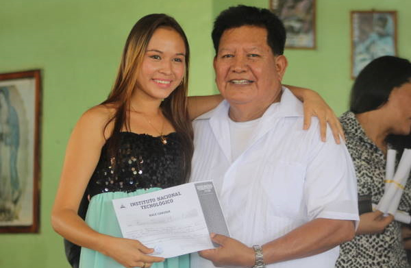 Lisseth with her teacher, receiving a technical degree