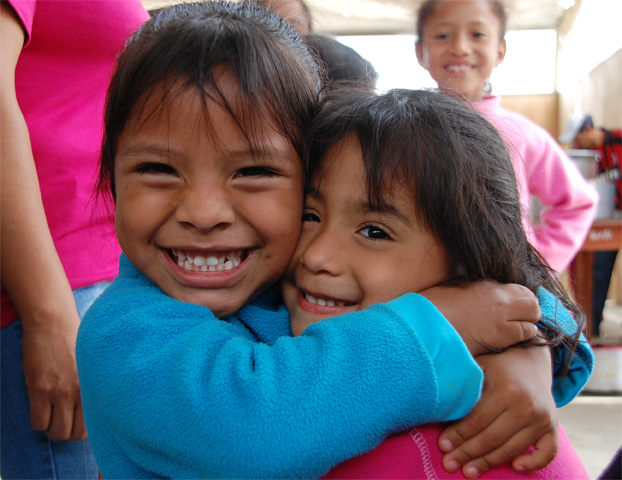 Maria (left), age 5, two years after joining the NPH Peru family