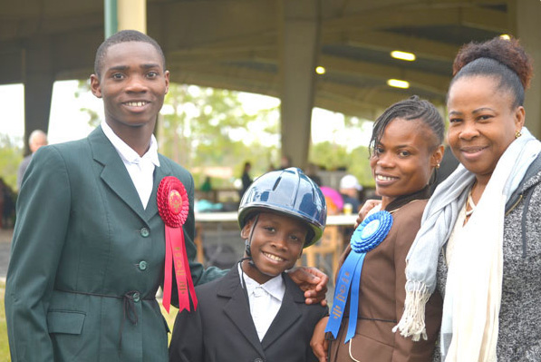 Estime*, Anderson* and Darline* accompanied by a supporter