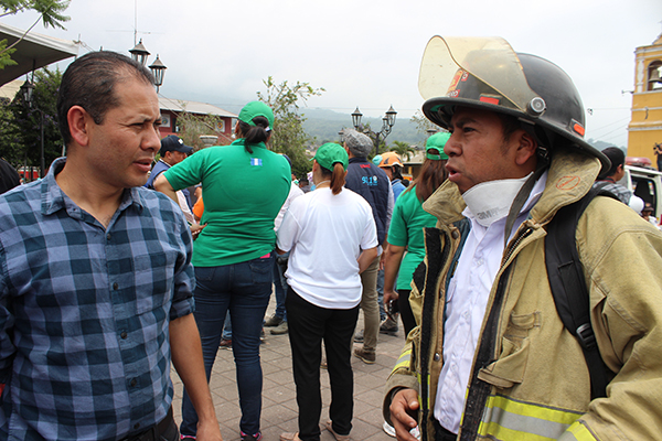 Orlando Ramos, National Director of NPH Guatemala, and Tio Eliseo, a volunteer firefighter, visit Alotenango, a town devastated by the disaster