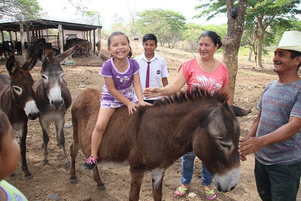 Marleny enjoys a donkey ride