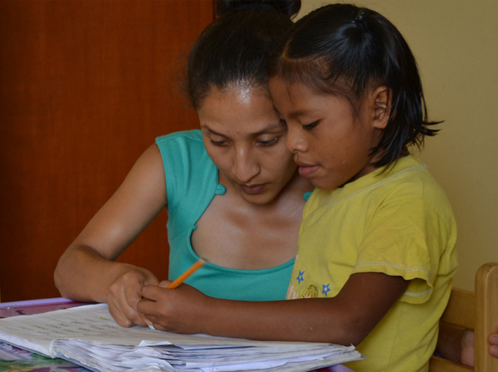 Teacher and student at NPH Peru