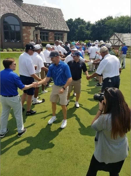 NPH USA National Board Member and Golf Outing Committee Member Gary Rabine shaking hands with Bob Costas at the end of the tunnel.