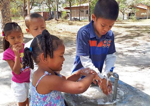 Children washing their hands at NPH Honduras